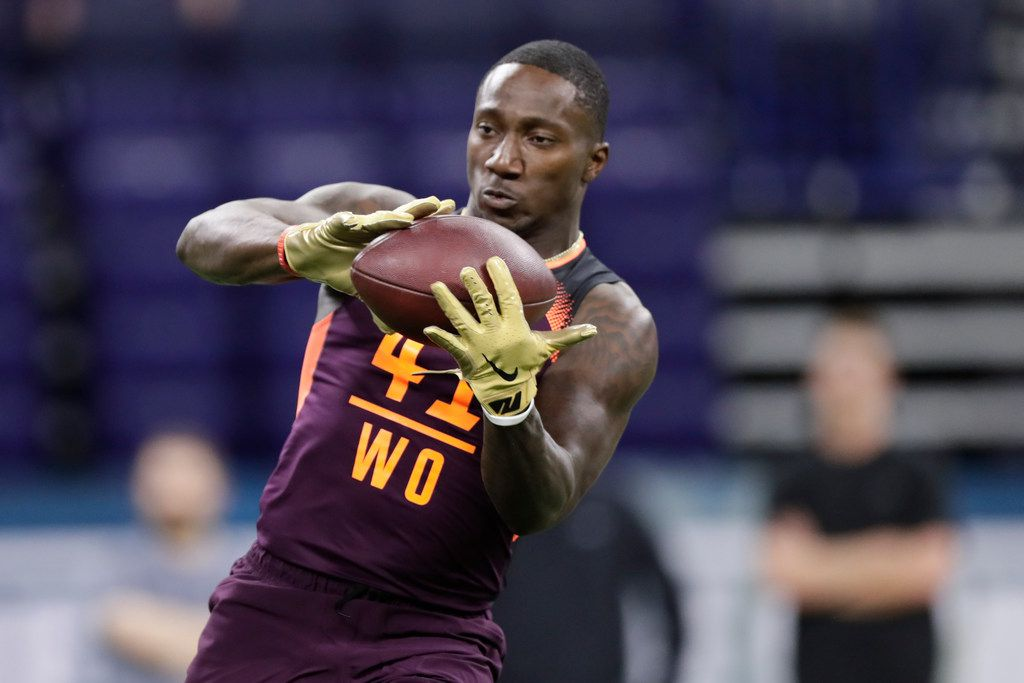 South Carolina wide receiver Deebo Samuel runs a drill at the NFL football scouting combine in Indianapolis, Saturday, March 2, 2019. (AP Photo/Michael Conroy)