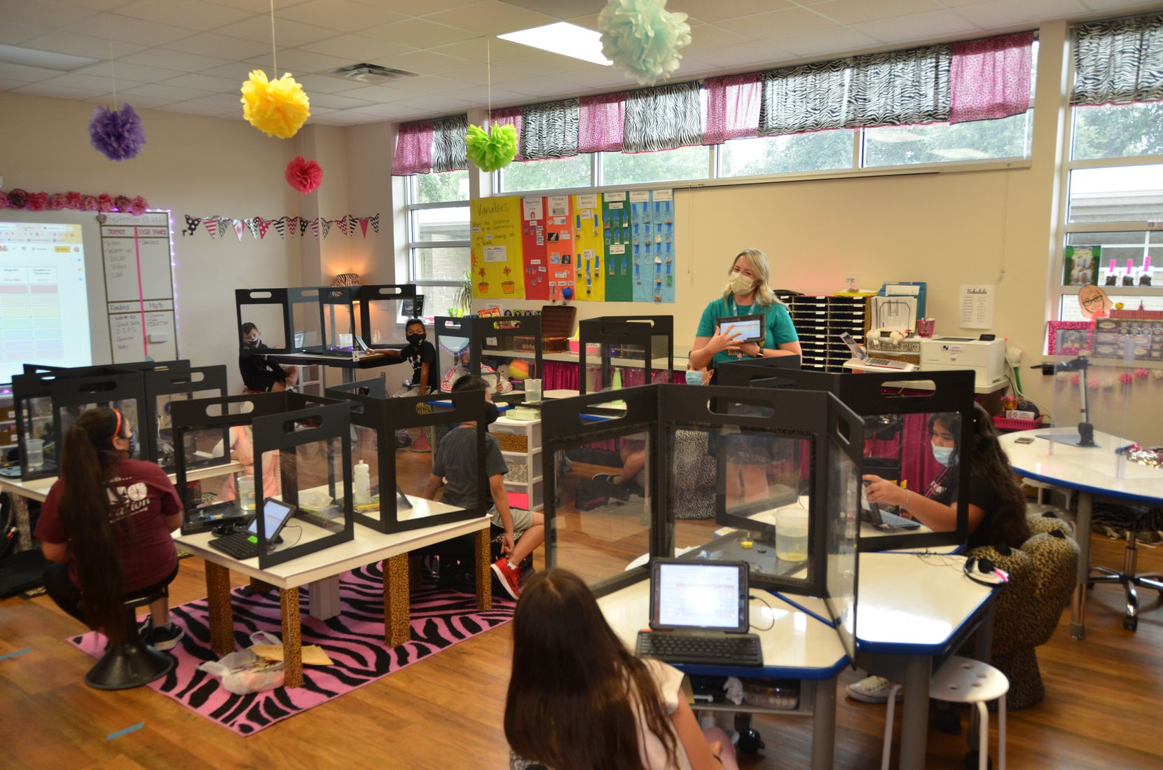Northwood Hills Elementary School teacher Lauren Martinez speaks to her fifth grade students, only some of whom have returned to in-person learning.
