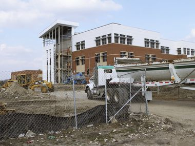 Dallas ISD will ask voters to approve a nearly $3.7 billion bond package in November, which will renovate and modernize nearly every building across the district, and build 14 replacement campuses and 10 new facilities. Pictured is construction at Ann Richards Middle School in Pleasant Grove, which was completed in 2012.