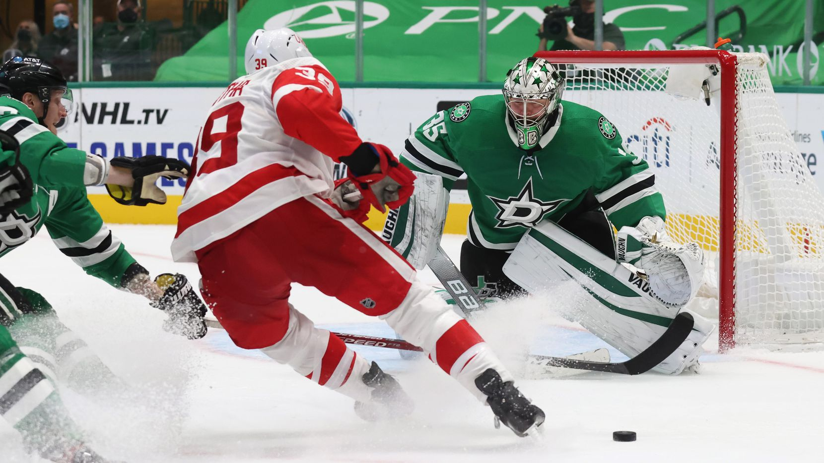Dallas Stars goaltender Anton Khudobin (35) defendsd the goal as Detroit Red Wings right wing Anthony Mantha (39) advances during the overtime at American Airlines Center on Tuesday, January 26, 2021in Dallas.