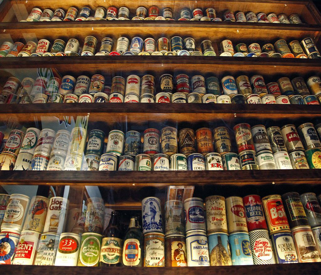 A showcase filled with beer cans and bottles from around the world at Ron's Place in Addison on Friday, October 1, 2015.