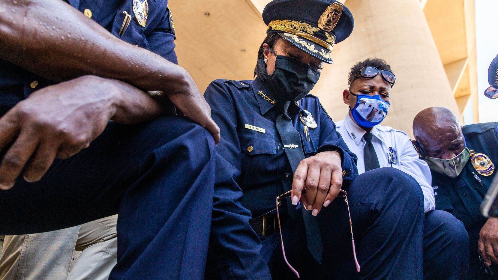 Chief U. Renee Hall (center) and other officers kneel for 8 minutes and 46 seconds during the Blue for Black Lives demonstration led by Dallas Police in response to the murder of George Floyd at Dallas City Hall in Dallas on Friday, June 5, 2020. The demonstration took place on the eighth day of organized protests in response to the recent deaths of George Floyd in Minneapolis and Breonna Taylor in Louisville.