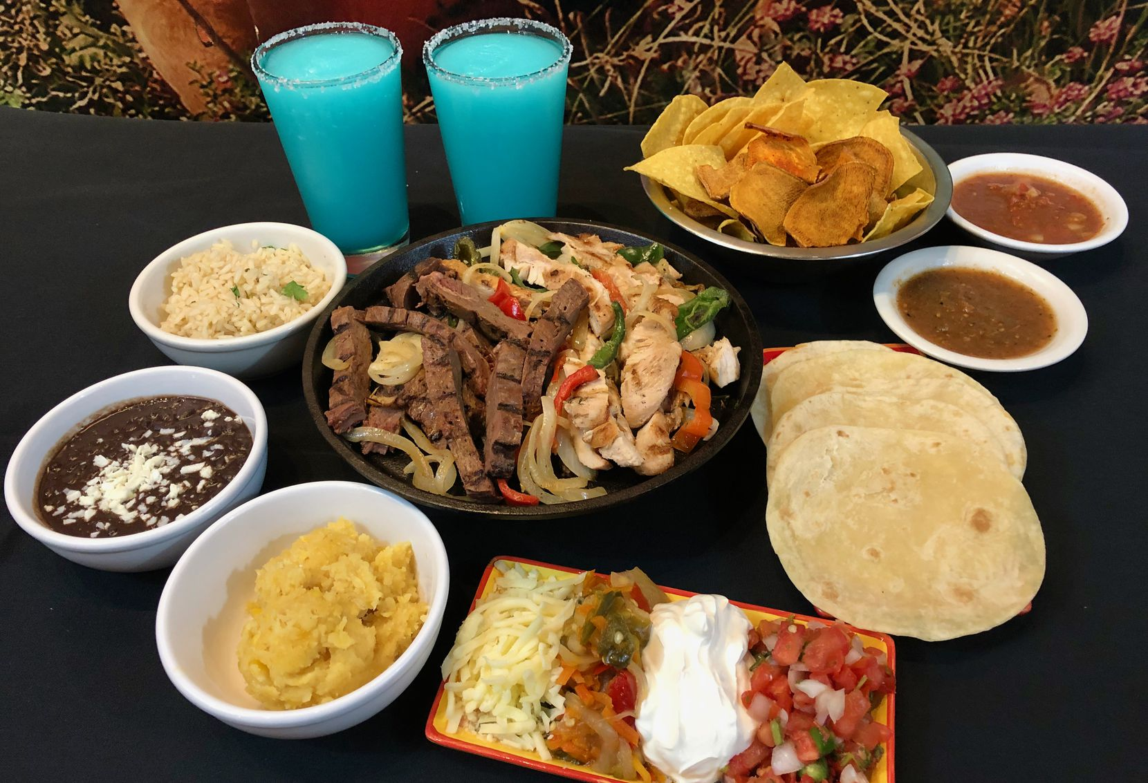 Blue Mesa Grill offers a free quart of blue margaritas with the purchase of a $55 family pack.
