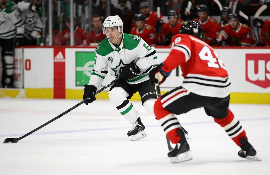 CHICAGO, IL - FEBRUARY 08:  Julius Honka #6 of the Dallas Stars advances the puck against Vinnie Hinostroza #48 of the Chicago Blackhawks at the United Center on February 8 2018 in Chicago, Illinois. (Photo by Jonathan Daniel/Getty Images)
