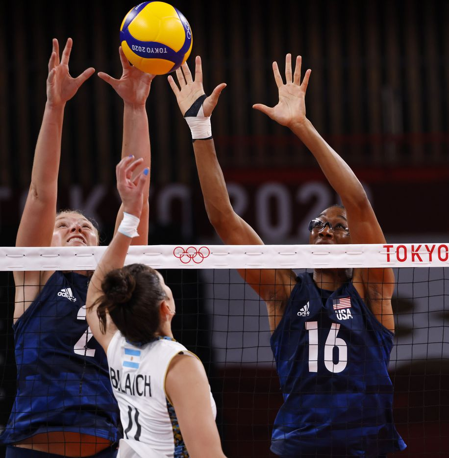 USA's Jordyn Poulter (2) and Foluke Akinradewo (16) prepare to block a ball hit by Argentina's Julieta Constanza Lazcano (11) in a women's volleyball game during the postponed 2020 Tokyo Olympics at Ariake Arena on Sunday, July 25, 2021, in Tokyo, Japan. USA defeated Argentina 3-0 (25-20, 25-19, 25-20). (Vernon Bryant/The Dallas Morning News)