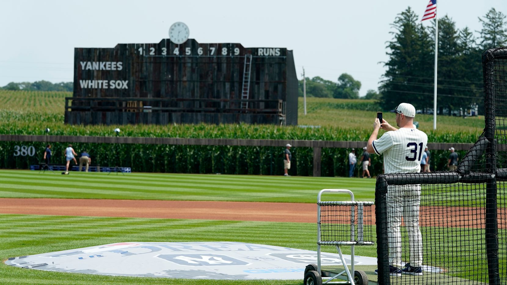 Chicago White Sox relief pitcher Liam Hendriks takes a photo on the field before a baseball game against the New York Yankees, Thursday, Aug. 12, 2021, in Dyersville, Iowa.