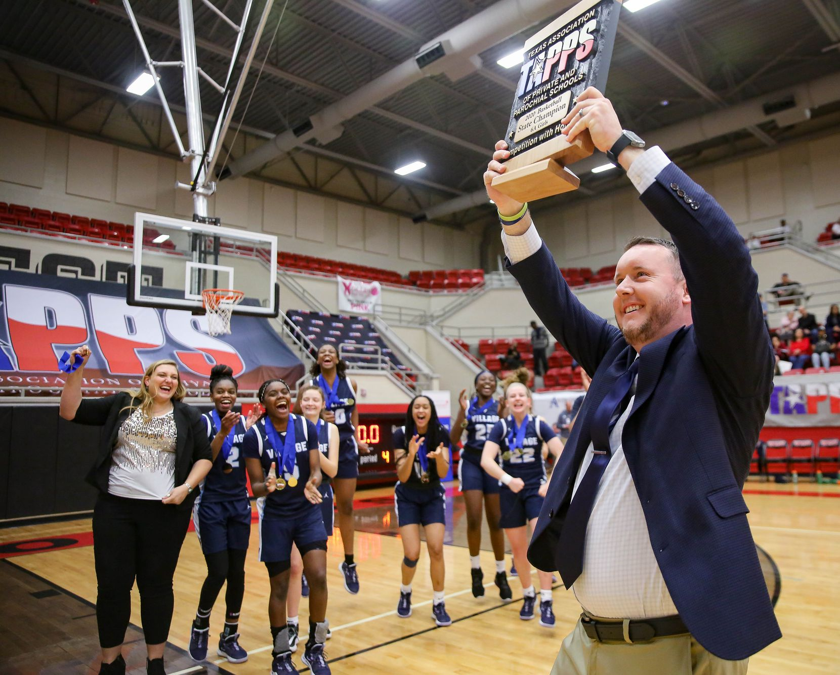 The Village School coach Doug Brotherton celebrates after beating Plano Prestonwood Christian during a TAPPS Class 6A girls basketball state championship game on Feb. 28, 2020 in West. Prestonwood lost 75-48.