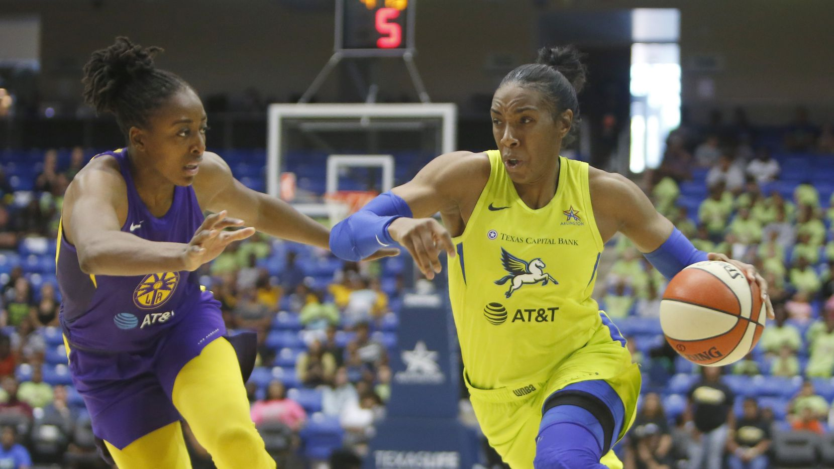 Dallas Wings forward Kayla Thornton (6) drives to the basket past the defense of Los Angeles Sparks guard Nneka Ogwumike (30) during first half action. The Wings defeated the Sparks, 74-62. The two teams played their WNBA game at College Park Center in Arlington on July 9, 2019.