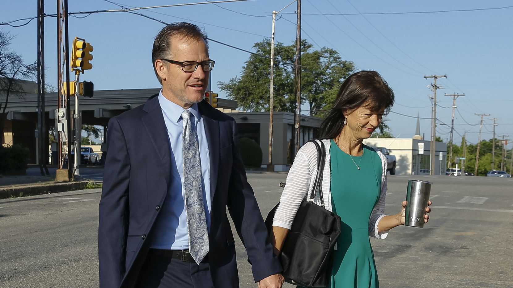 Mark Jordan and former Richardson Mayor Laura Jordan enter the Paul Brown Federal Building United States Courthouse on Friday, July 23, 2021, in Sherman. The Jordans are on trial for the second time for bribery after a court security officer's remark resulted in a new trial.