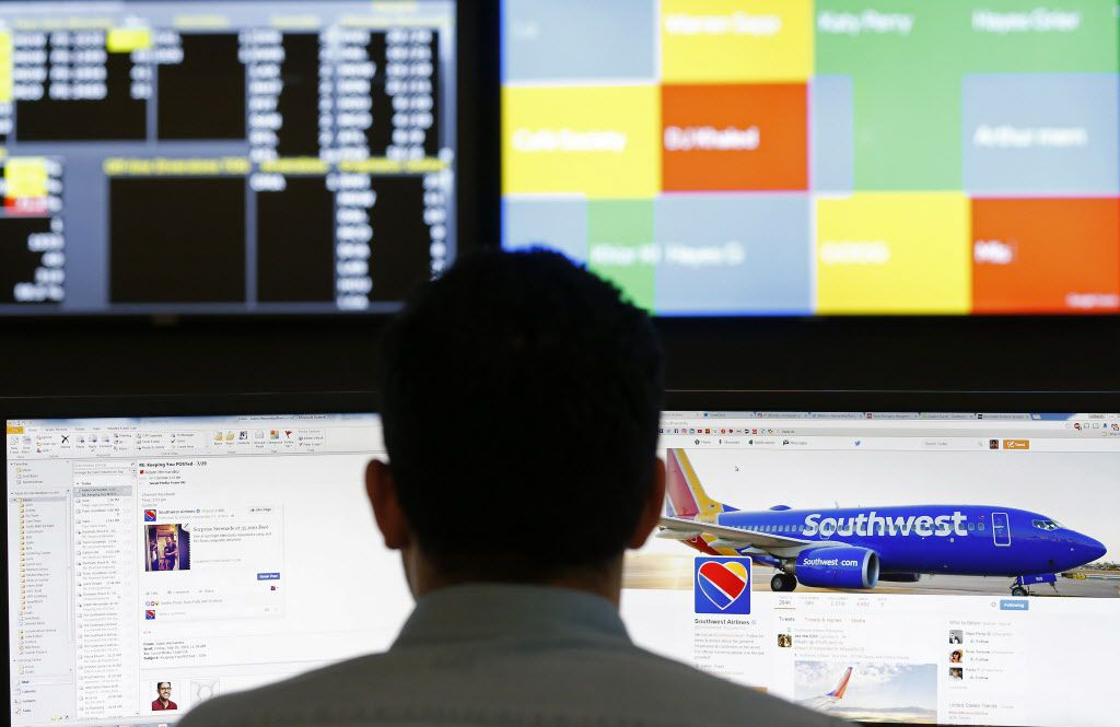 Social business specialist Adam Hernandez monitors the Southwest Airlines twitter account on the right screen inside the Listening Center at the Southwest Airlines headquarters in Dallas, Friday, July 29, 2016. Members of the Southwest Airlines' social team monitor and manage the company's social media platforms. (Jae S. Lee/The Dallas Morning News)