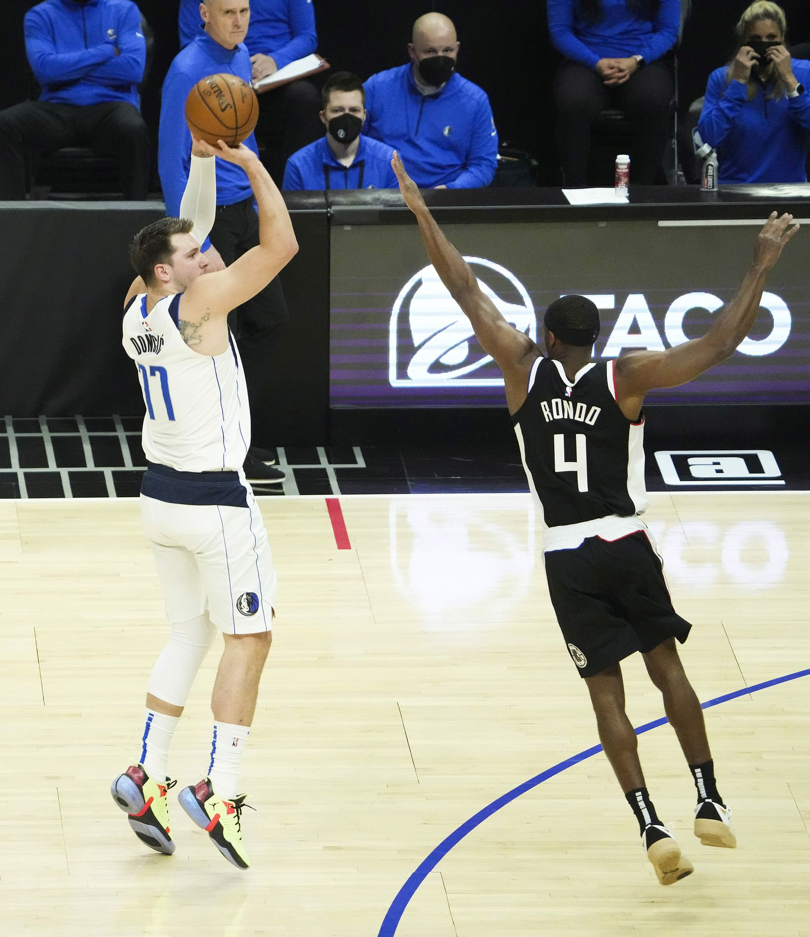 Dallas Mavericks guard Luka Doncic (77) shoots a 3-pointer over LA Clippers guard Rajon Rondo (4) during the first quarter of Game 7 of an NBA playoff series at the Staples Center on Sunday, June 6, 2021, in Los Angeles.