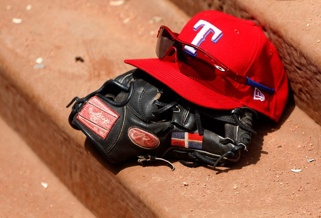 Texas Rangers third baseman Adrian Beltre's hat, glove and sunglasses sit on the dugout steps in the third inning at Globe Life Park in Arlington, Sunday, July 30, 2017. (Tom Fox/The Dallas Morning News)