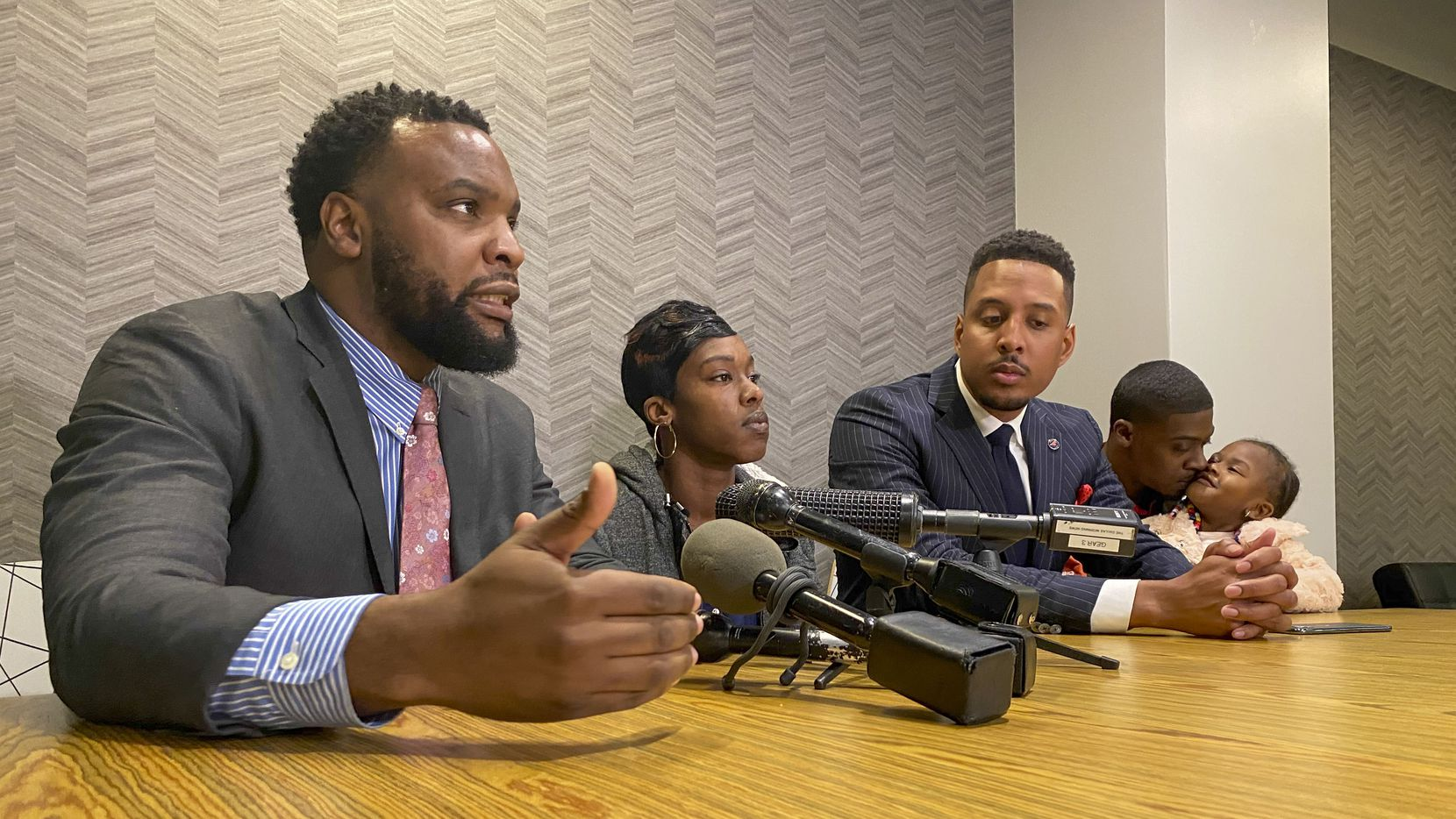 Attorney Lee Merritt (left), Shabreeka Kennedy and Attorney Justin Moore discuss the medical examiner's report on Rashad Madden during a press conference in Dallas Tuesday January 14, 2020. (Brian Elledge/Staff Photographer)