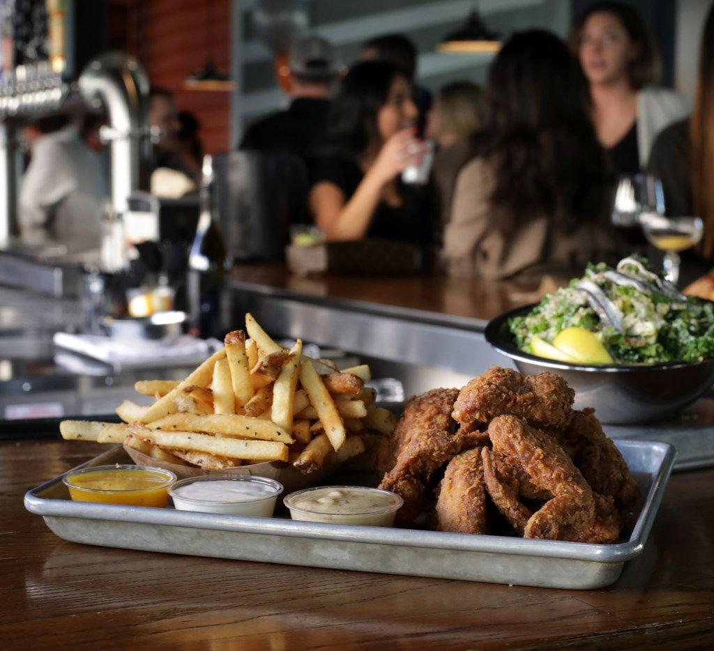 One spot that fulfills Legacy Hall's potential is Roots Chicken Shak, where chef Tiffany Derry serves duck-fat fried chicken wings.
