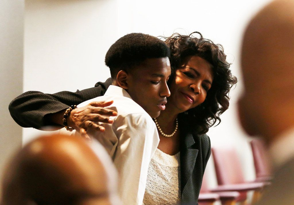 Dallas County District Attorney Faith Johnson hugs Kevon Edwards after former officer Roy Oliver was convicted of murdering Edwards' brother, Jordan. (Rose Baca/Staff Photographer)