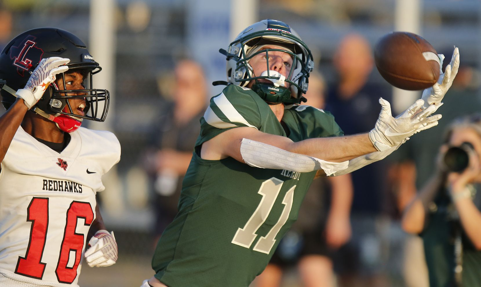Reedy High School wide receiver A.J. Jayroe (11) gets behind Liberty High School cornerback Cameron Wooley (16) but was ruled not a catch during the first half as Reedy High School hosted Frisco Liberty High School at David Kuykendall Stadium in Frisco on Wednesday night, August 26, 2021. (Stewart F. House/Special Contributor)
