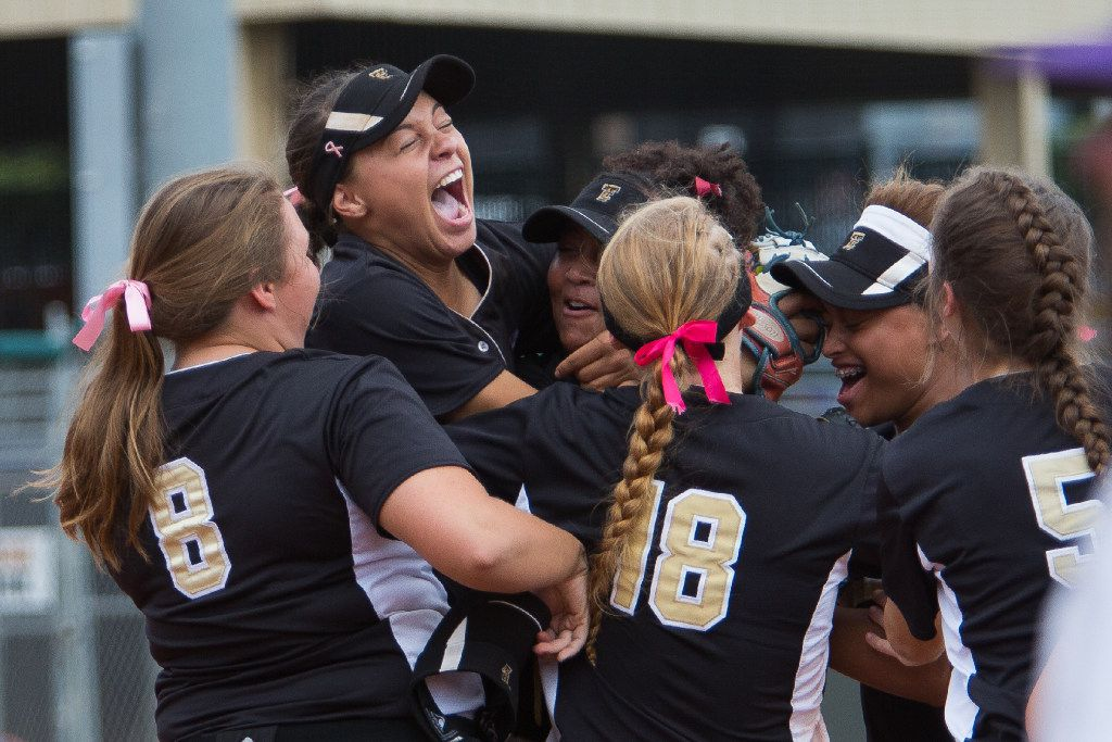 Jayda Coleman, second from left, celebrates making a catch for the final out of the semi-final round of the UIL Girls 5A softball tournament at the McCombs Field in Austin, Texas on Friday June 2, 2017. The Colony Cougars beat the Canyon Eagles 3-0 and advance to the state final game on Saturday.  (Julia Robinson/Special Contributor)
