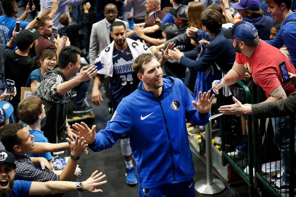 Dallas Mavericks forward Dirk Nowitzki (41) slaps hands with fans as he leaves the court following their game against the Memphis Grizzlies at the American Airlines Center in Dallas, Friday, April 5, 2019. The Mavericks lost, 122-112.(Tom Fox/The Dallas Morning News)