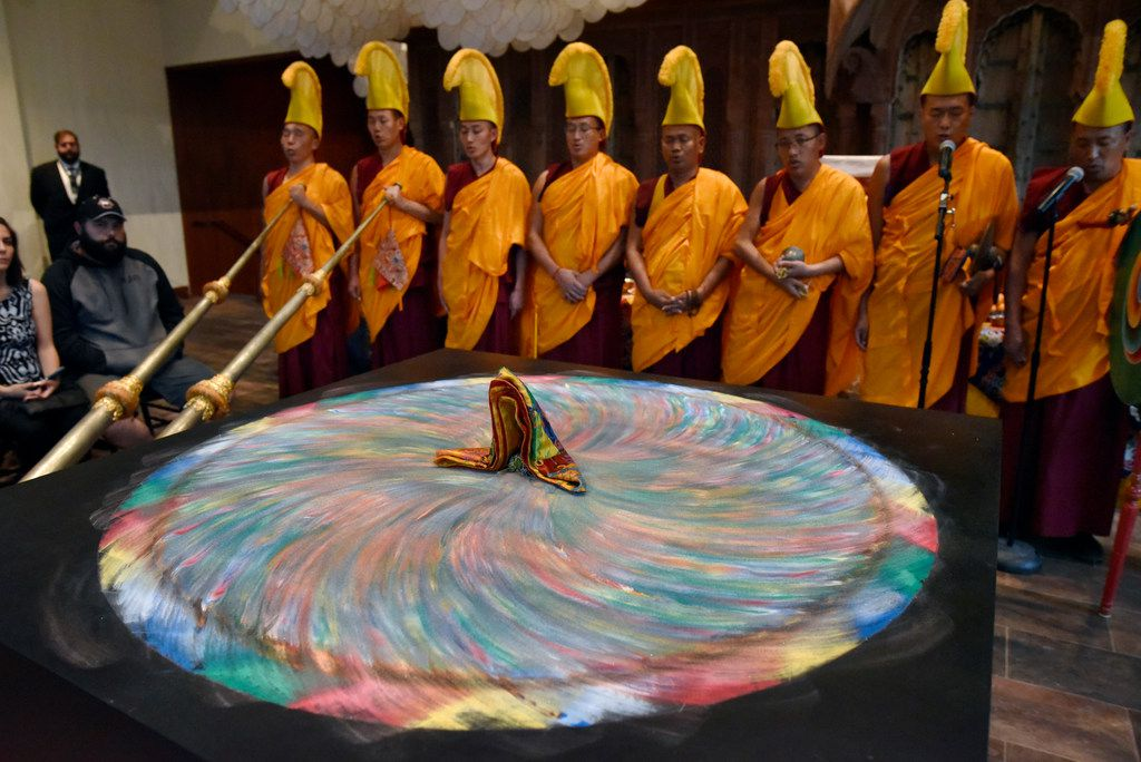 A group of Buddhist monks chant after destroying a mandala, part of the closing ceremonies of the Mystical Arts of Tibet at the Crow Museum of Asian Art in downtown Dallas on Saturday, Oct. 13, 2018.