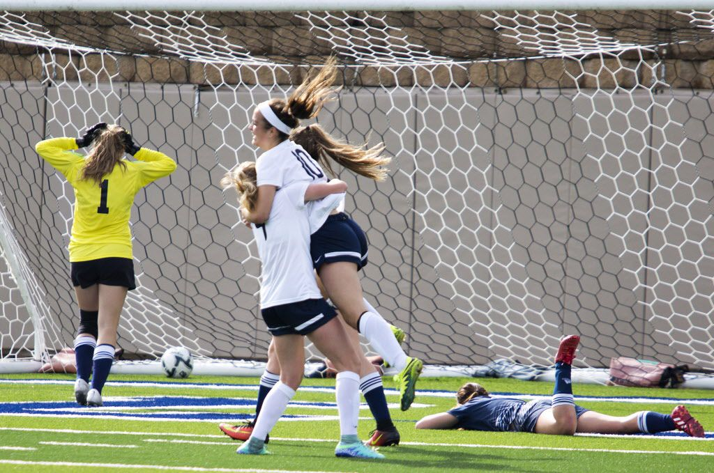 A Boerne Champion defender (right) is left on the ground as Highland Park midfielder Frances Ann Matise (9) and forward Presley Echols (10) celebrate after Echols scored on Boerne Champion Goalkeeper Sarah Schlemmer (1, back left) to make the first goal of the game during their UIL 5A girls semifinals soccer game at Birkelbach Field on April 13, 2017 in Georgetown, Texas.  (Thao Nguyen/Special Contributor)