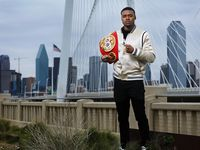 Dallas boxer Errol Spence Jr. poses for a photo with his belt on the Continental Bridge in Dallas, Monday, March 4, 2019.