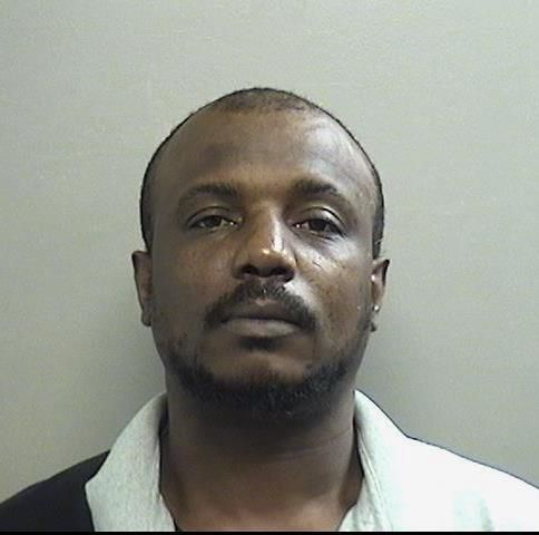 Romus Antwan Motton, 39, faces a murder charge in connection with the fatal shooting of Wiley Harper, 40, on May 3, 2020.