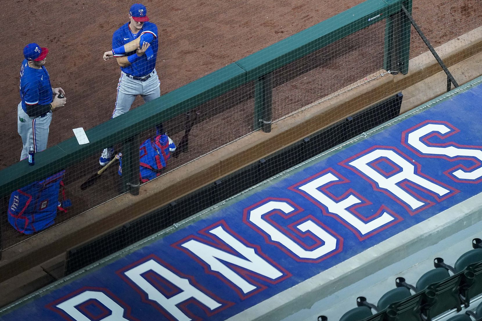 FILE - Catcher Sam Huff (left) and infielder Josh Jung put on their gear before an intrasquad game during Rangers summer camp at Globe Life Field on Friday, July 17, 2020.
