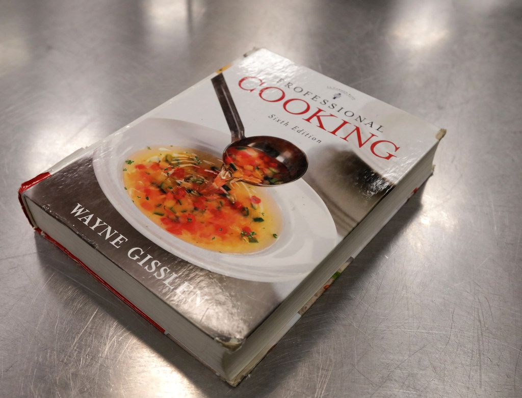 The students use 'Professional Cooking' by Wayne Gisslen as their guide.