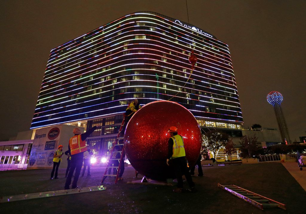 Workers install a giant red Christmas ornament outside the Omni Dallas Hotel in Dallas, Wednesday, Nov. 15, 2017. In 2019, a streetcar could come by, too.