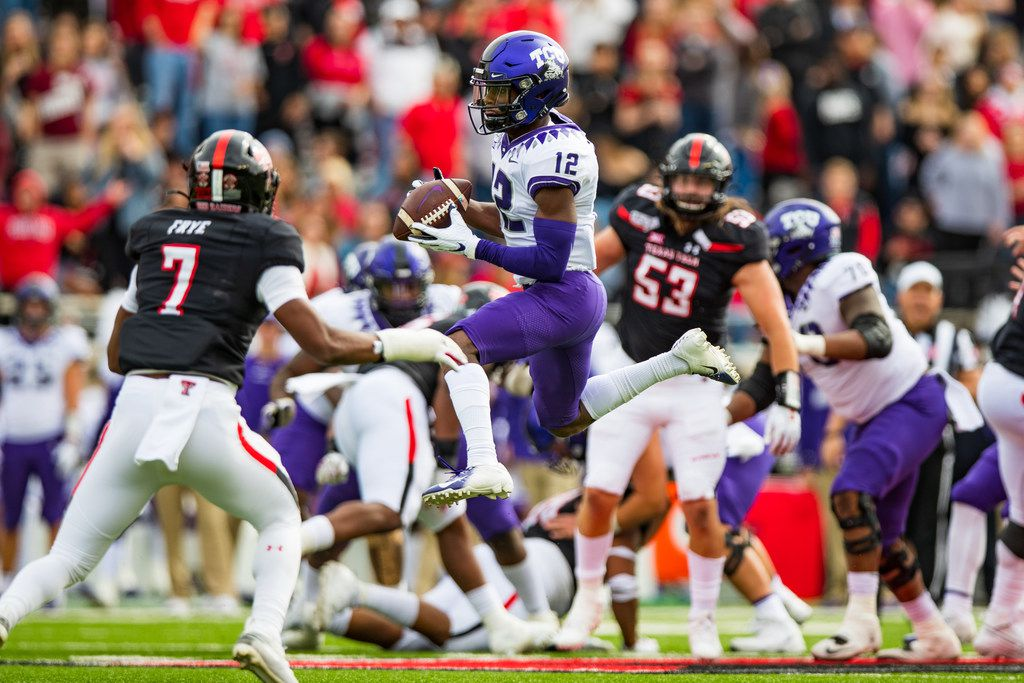 LUBBOCK, TEXAS - NOVEMBER 16: Wide receiver Derius Davis #12 of the TCU Horned Frogs leaps to make a catch during the first half of the college football game against the Texas Tech Red Raiders on November 16, 2019 at Jones AT&T Stadium in Lubbock, Texas.