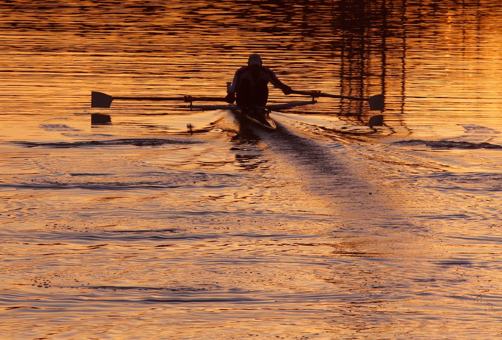 A rower moves across Bachman Lake in Dallas at sunset on Feb. 7, 2018. The lake is a 205-acre fresh body of water on the north side of Dallas Love Field.