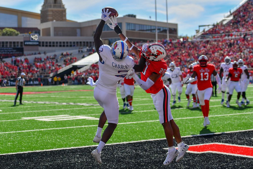 LUBBOCK, TX - OCTOBER 20: Adrian Frye #20 of the Texas Tech Red Raiders breaks up a pass intended for Daylon Charlot #2 of the Kansas Jayhawks during the first half of the game on October 20, 2018 at Jones AT&T Stadium in Lubbock, Texas.