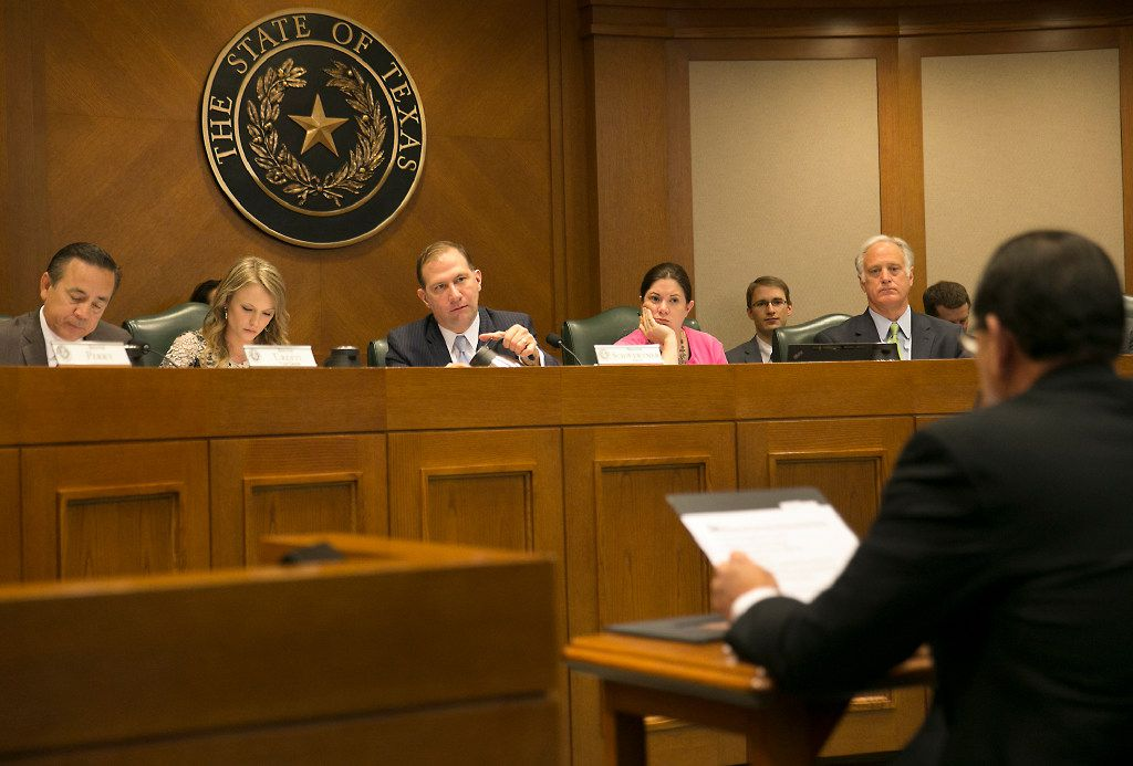 """Texas protective services chief Henry """"Hank"""" Whitman, right, shown testifying to the Senate panel on Feb. 2, has urged that the procurement method known as """"foster care redesign"""" be up and running in 10 regions of the state by August 2019. (Ralph Barrera/Austin American-Statesman)"""
