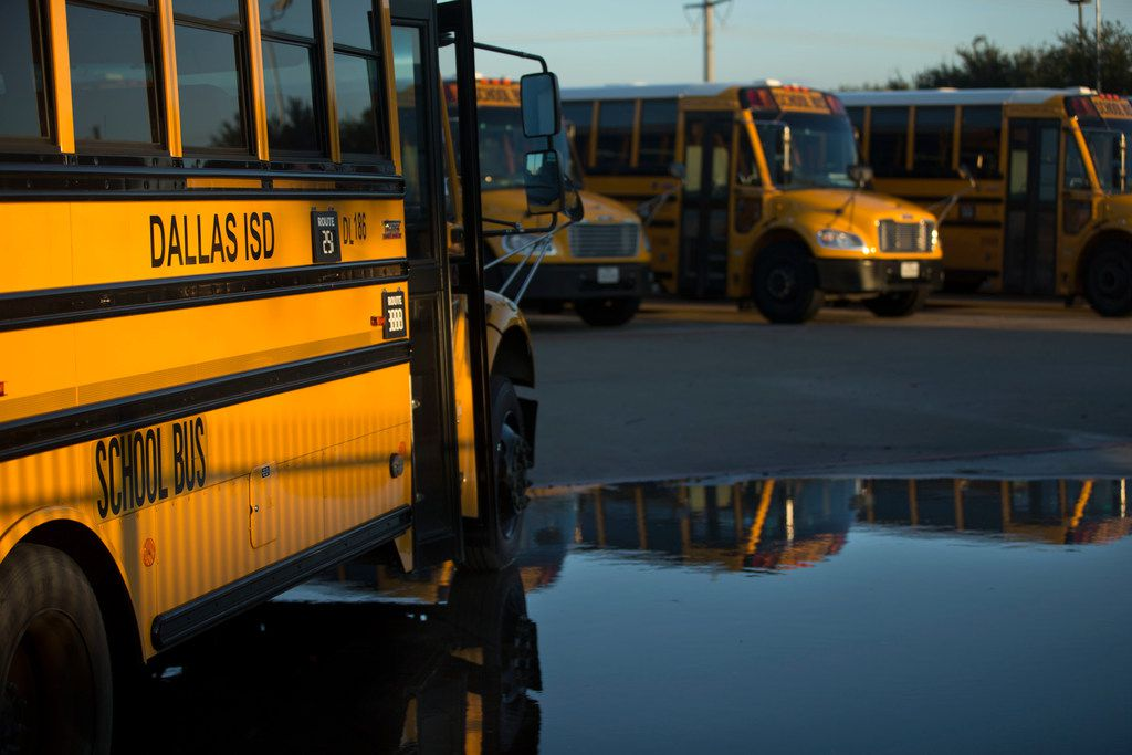 Dallas Independent School District school buses parked at the district's bus lot in Dallas on Sunday, December 9, 2018.