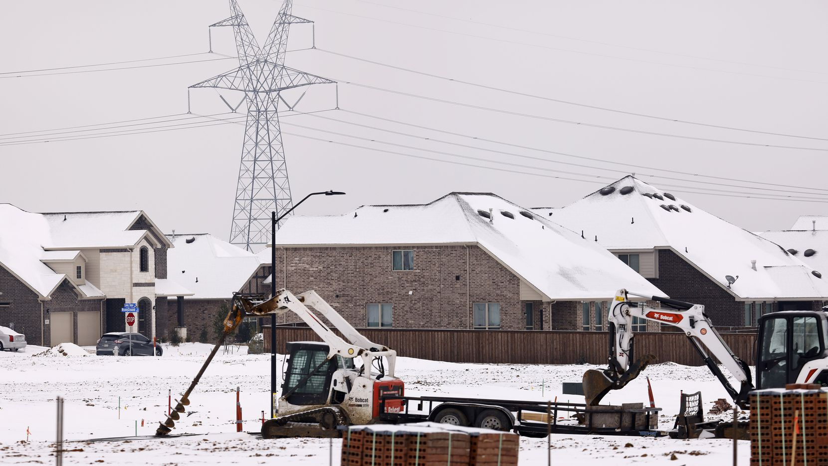 Large electrical transmission lines are pictured in a new housing development in South Arlington, Wednesday, February 17, 2021. Rolling power outages have disrupted service to customers following this weeks snow storm and deep freeze. (Tom Fox/The Dallas Morning News)