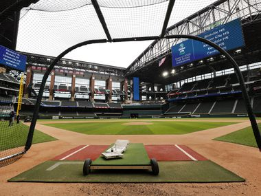 Texas Rangers players have been using a batting cage on the field of the newly completed Globe Life Field in Arlington, Texas, Wednesday, May 20 2020. The stadium is also getting ready to host several high school graduations.