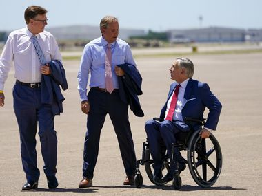 Texas Lt. Gov. Dan Patrick, Attorney General Ken Paxton and Gov. Greg Abbott await the arrival of President Donald Trump at Dallas Love Field on Thursday, June 11, 2020, in Dallas.