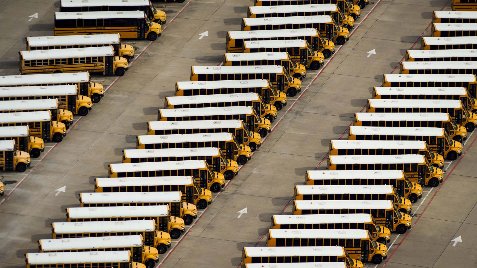 Aerial view of idle school buses at the Dallas ISD Student Transportation Services North Dallas Lot  2498 Rentzel Street on Wednesday, April 1, 2020, in Dallas, Texas.
