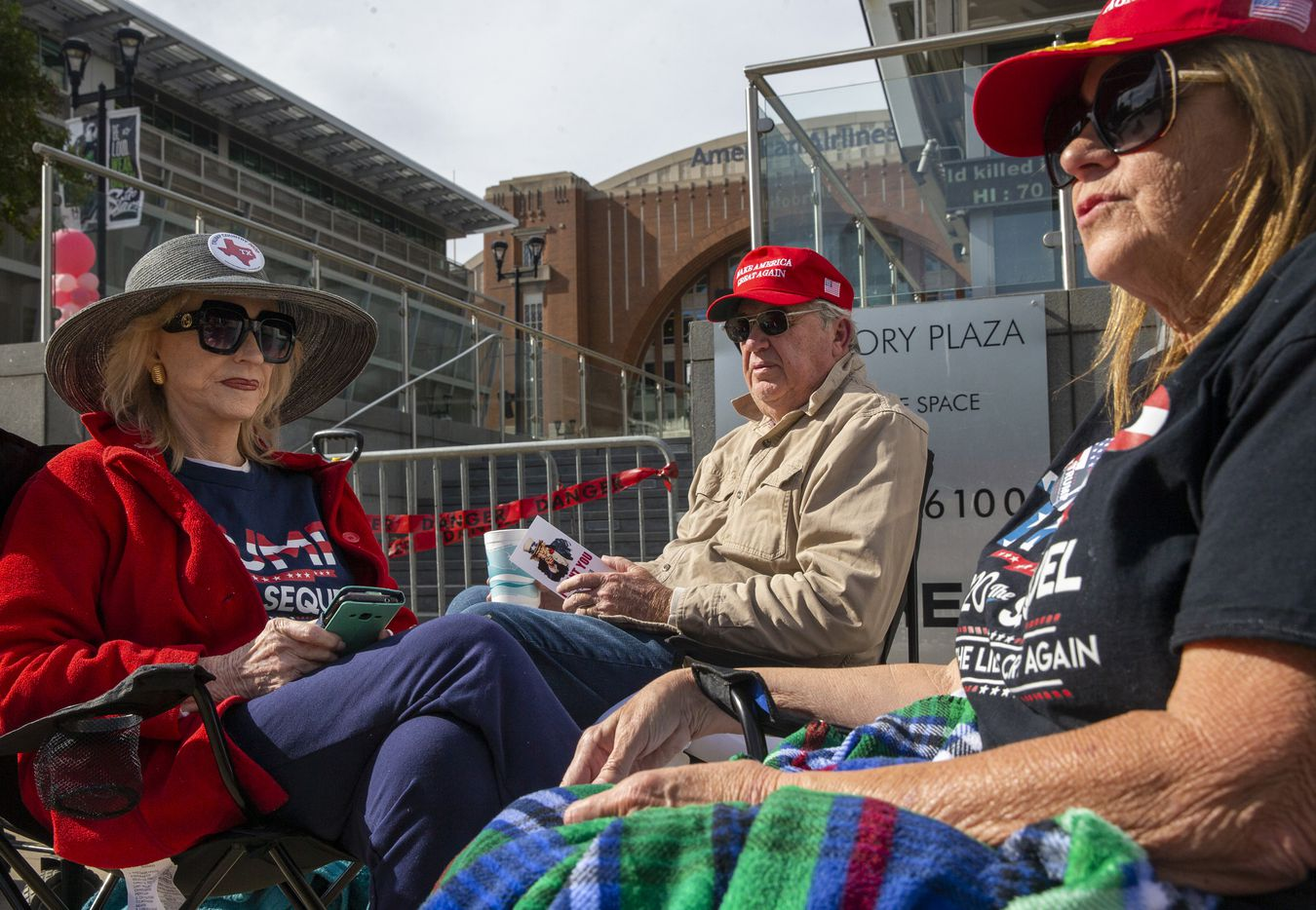 (From left) Janice Hawley and Jay Hawley, from Dallas, and Benita Russell from Fort Worth, Texas, camp out in line in front of the American Airlines Center in Dallas on Wednesday, Oct. 16, 2019. President Donald Trump will host a rally at the center on Thursday evening.