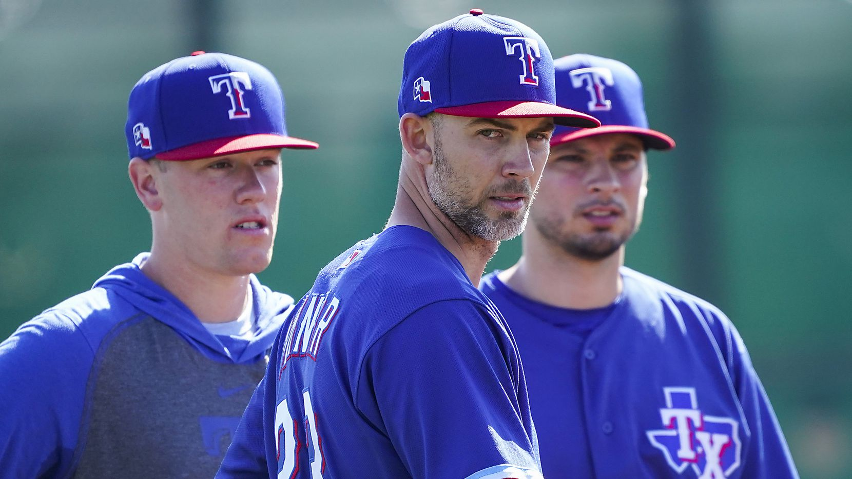 Texas Rangers pitcher Mike Minor (participates in a fielding drill during a spring training workout at the team's training facility on Sunday, Feb. 16, 2020, in Surprise, Ariz.