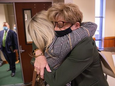 Cheryl Pangburn (left) and Shannon Dion hug after testifying before the House Committee on Public Health in Austin on Wednesday, March 17, 2021. The two are co-founders of the nonprofit Secure Our Seniors' Safety.