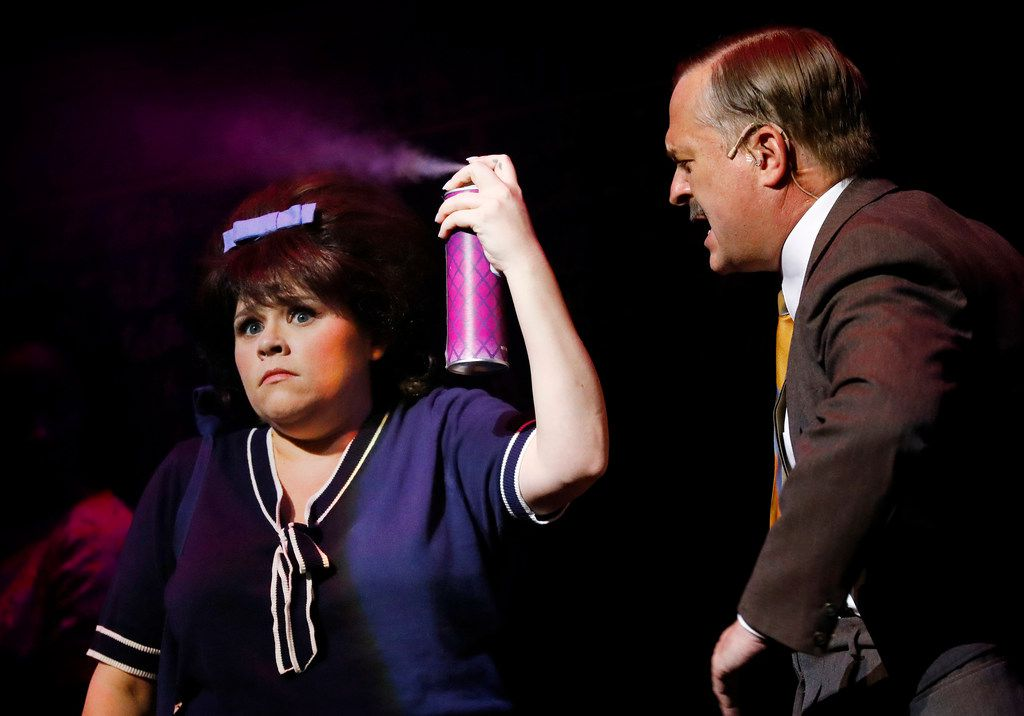Michelle Dowdy playing Tracy Turnblad (left) performs a scene with Rob McCollum playing the high school principal during  a dress rehearsal of Hairspray! on Saturday, July 7, 2018. (Tom Fox/The Dallas Morning News)