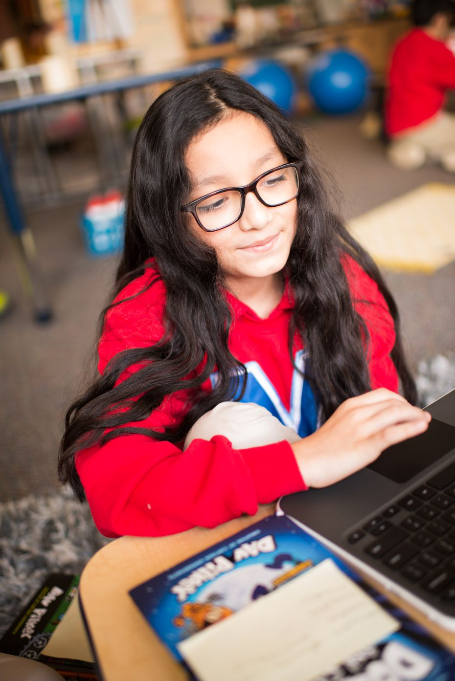 A student at the Momentous School completes an assignment online. AT&T provided hot spots to the Momentous Institute earlier this year to help ensure students can access the internet from anywhere.