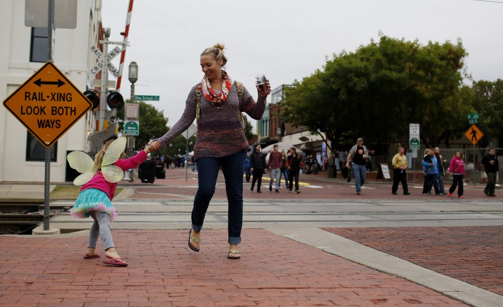 Meghan Skirha dances with daughter Mara, 4, in the street as Historic Downtown Plano celebrated its first ever Oktoberfest event called SteinFest in downtown Plano, Texas, Sunday, October 25, 2015. (Anja Schlein/Special Contributor)