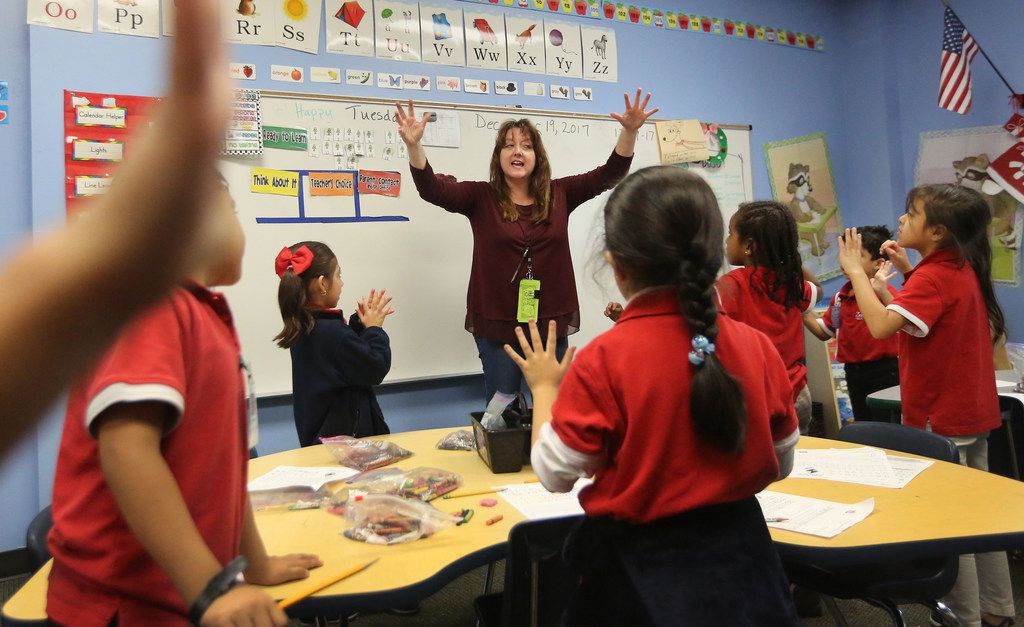 Kindergarten teacher Myka Moseley works with her students during morning class at the Harmony Science Academy Dallas campus on Forestgate Drive in Dallas. (Louis DeLuca/Staff Photographer)