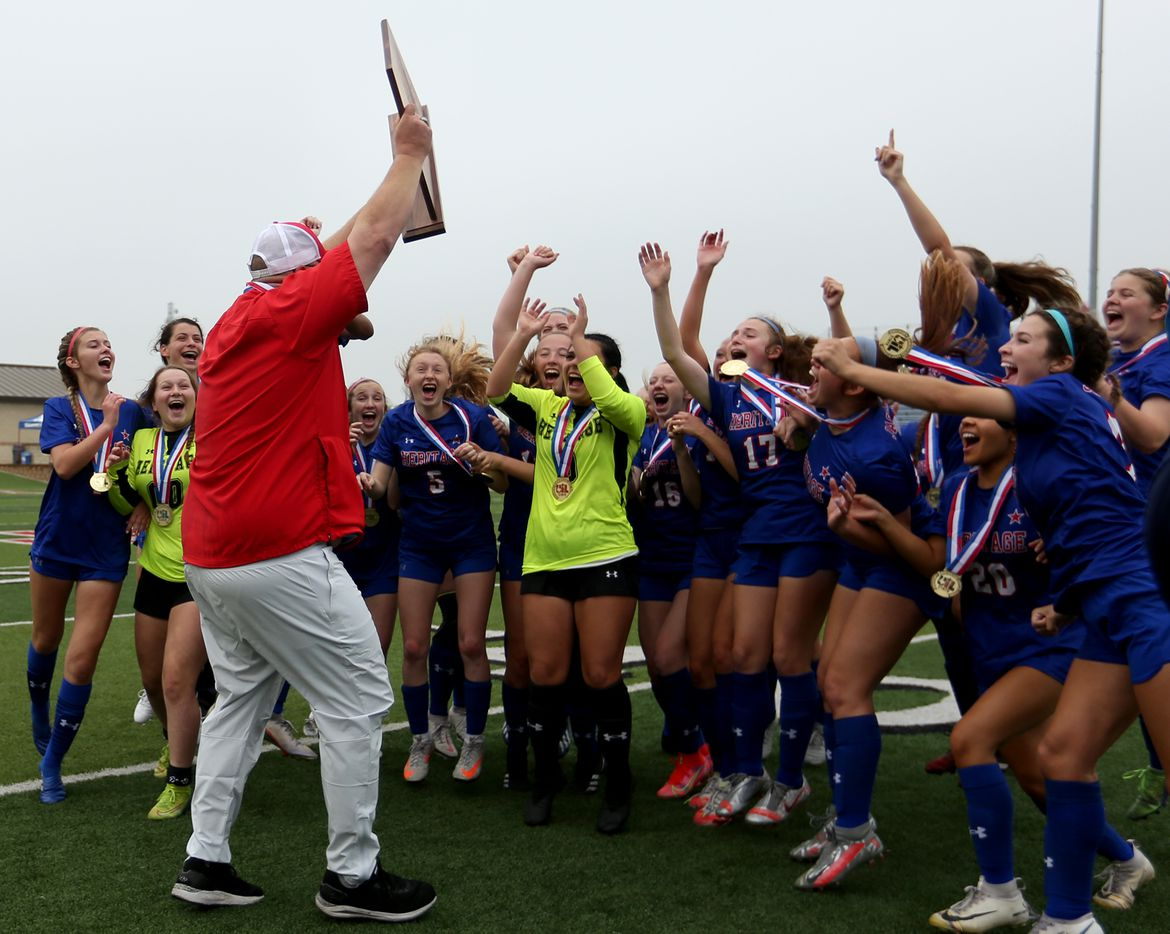 Midlothian Heritage head coach Gerald Slovacek cheers with his players as he holds up the trophy during their win over Calallen at their UIL 4A girls State championship soccer game at Birkelbach Field on April 16, 2021 in Georgetown, Texas.  (Thao Nguyen/Special Contributor)