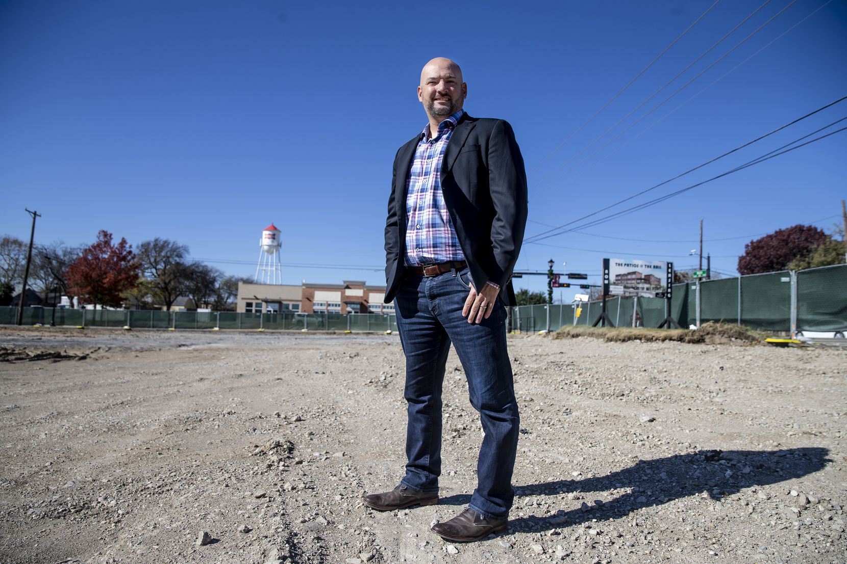 Developer Donny Churchman of Nack Development stands in the lot where he plans to build one of his projects on Main Street in downtown Frisco.