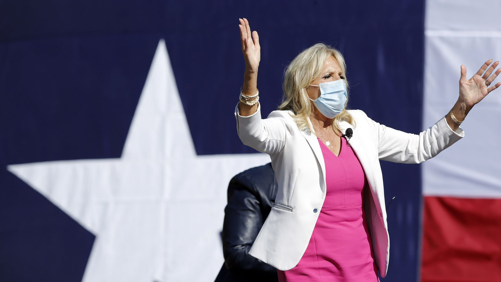 On the first day of early voting, former second lady Jill Biden waves to her supporters as she made a drive-in campaign rally stop on behalf of her husband and Democratic Presidential candidate Joe Biden, at Fair Park in Dallas, Tuesday, October 13, 2020.