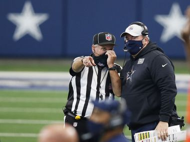 Cowboys head coach Mike McCarthy talks with an official after calling a timeout during the second half of a game against the Browns at AT&T Stadium in Arlington on Saturday, Oct. 4, 2020.