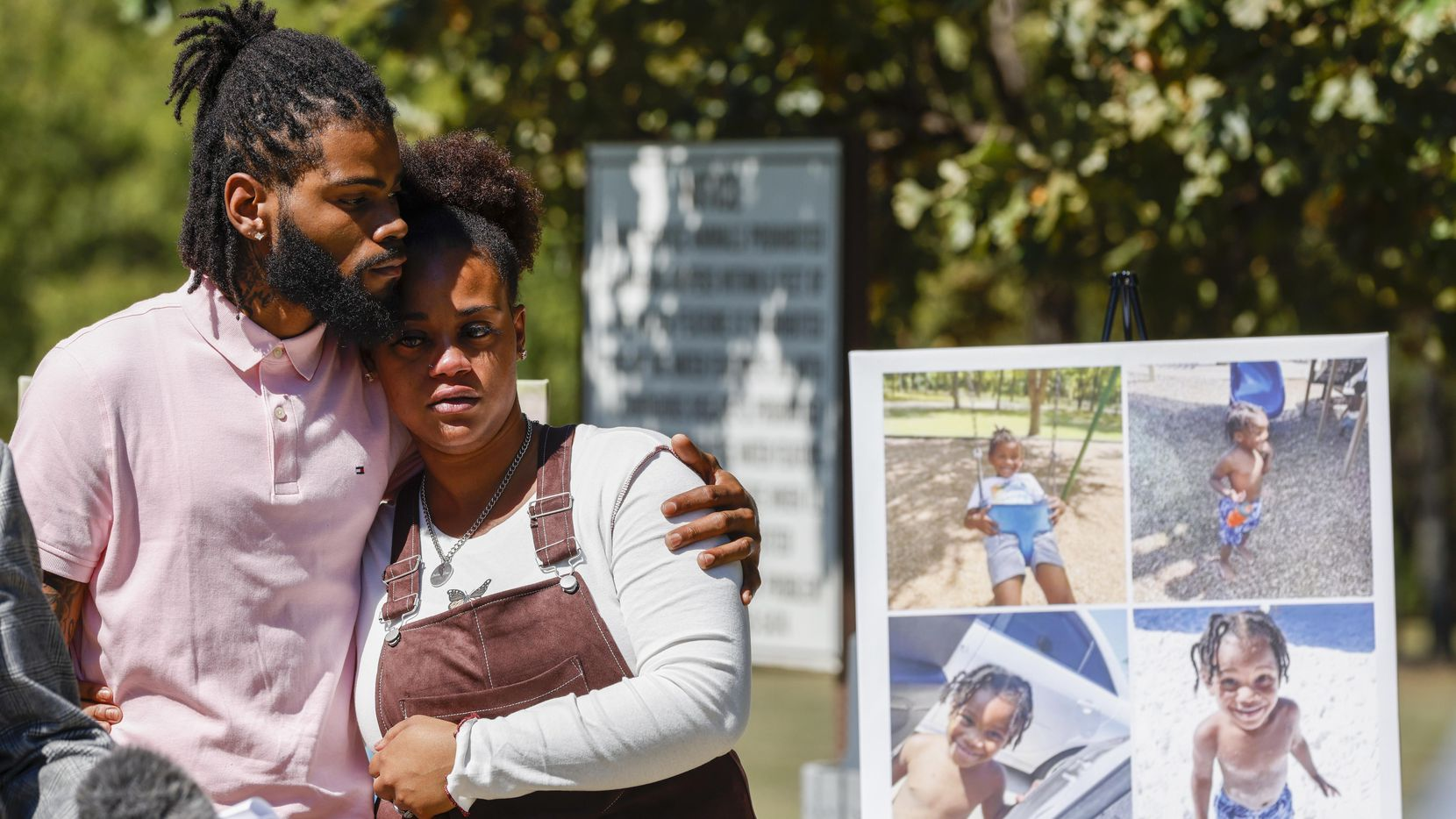 Tariq Williams (left) holds Kayla Mitchell, the parents of Bakari Williams, alongside photos of their son during a press conference at Don Misenhimer Park on Monday, Oct. 4, 2021, in Arlington. Three-year-old Bakari Williams died after contracting an amoeba from a city of Arlington splash pad. The family filed a lawsuit Monday morning against the city of Arlington for negligence. (Elias Valverde II/The Dallas Morning News)